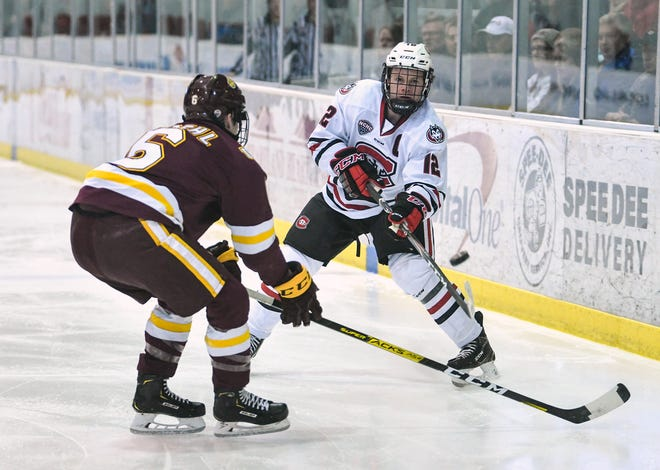 St. Cloud State's Jack Ahcan passes the puck along the boards during the first period of the Friday, Jan. 17, 2020, game at the Herb Brooks National Hockey Center in St. Cloud.