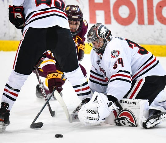 St. Cloud State goaltender David Hrenak concentrates on the puck during the first period of the Friday, Jan. 17, 2020, game against Minnesota-Duluth at the Herb Brooks National Hockey Center in St. Cloud.