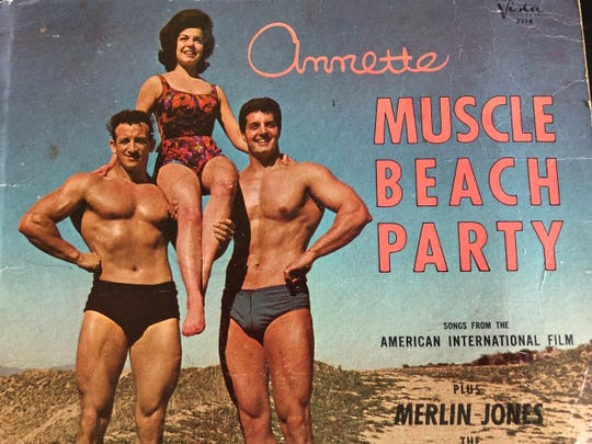 Bill Cunningham (left) poses with Annette Funicello and Peter Lupus, famous for his role as Willy Armitage in Mission Impossible, on the cover of the Muscle Beach Party album in 1964.