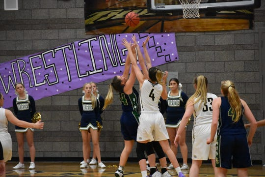 Desert Hills' Kami Bliss (4) defends against a Snow Canyon shot.