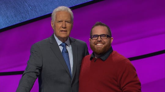 "Tallahasseean Gregory Bacon, who will appear on ""Jeopardy!,"" poses with Alex Trebec."