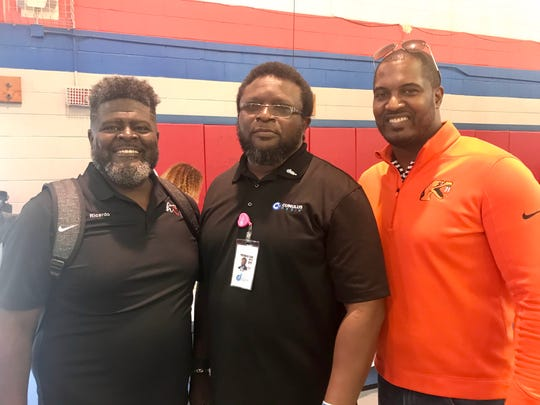Ricardo Lewis of Giving Hope Again (left) spearheaded the We Believe in Youth rally. He worked alongside DJ Dap of Blazin' 102.3 FM and FAMU football head coach Willie Simmons.
