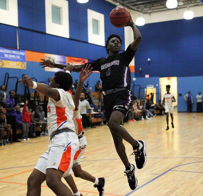Crossroad senior De'Onta Jones drives for a finger-roll layup as Crossroad Academy's boys basketball team beat Jefferson County 92-68 on Jan. 17, 2020.