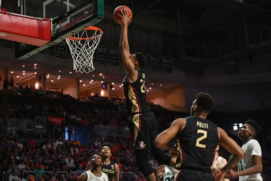 Jan 18, 2020; Coral Gables, Florida, USA; Florida State Seminoles guard Devin Vassell (24) dunks the ball against the Miami Hurricanes during the first half at Watsco Center. Mandatory Credit: Jasen Vinlove-USA TODAY Sports