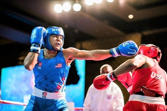Darius Fulghum throws a jab against an opponent during a qualifying fight. He hopes to earn a spot on the national team for the 2020 Summer Olympics in Tokyo.