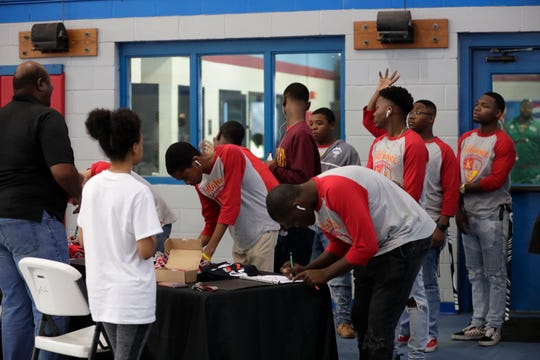 Youth sign in at the door as they come to participate in the We Believe in Youth Rally on Saturday, Jan. 18, 2020.