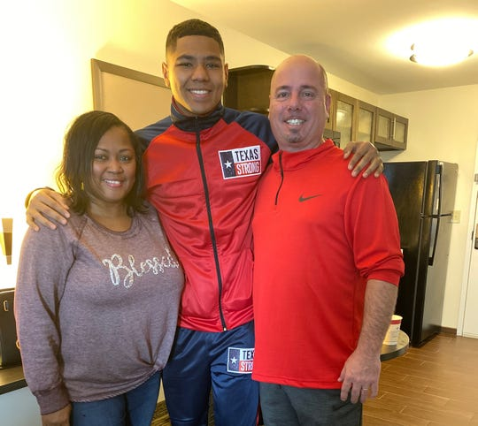 Boxer Darius Fulghum (center) poses with his parents Tim and Kosheryl. His father graduated from FAMU High School and Florida A&M University. Kosheryl is an alum of Rickards High School and Tallahassee Community College.