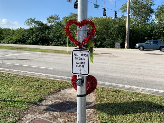 Hearts were added to the roadside memorial for Holy Cross rower Grace Rett on Indian River Boulevard, where she was killed in a traffic crash. The photo was taken January 18, 2020.