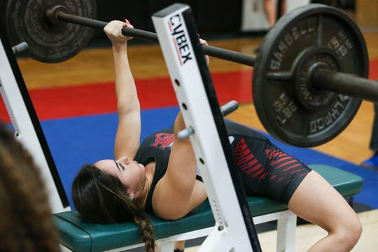 Vero Beach's Alyssa Depalo, in the 101-pound division, bench presses 120 pounds during the Treasure Lake Conference girls weightlifting competition at South Fork High School on Saturday Jan. 18, 2020, in Tropical Farms.