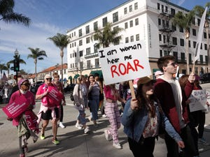 Marchers head up Main Street in downtown Ventura during a 2020 rally and march organized by Justice For All Ventura County.