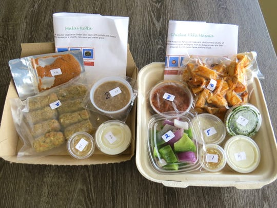 Meal kits for vegetarian malai kofta, left, and chicken tikka masala are seen at Fresh Curry Chefs. The dishes can also be made for dining in at the Camarillo restaurant specializing in Indian cuisine.