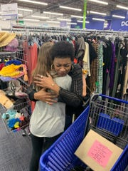 Jenna D'Orio of Vineland, a freshman at Our Lady of Mercy Academy in Newfield, gets a hug from a Smile Box recipient at the Goodwill Store. D'Orio presented the box as part of a Compassion Quest Mini-Mester course.