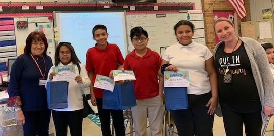 The Woman's Club of Vineland sponsored a spelling bee for fifth graders at D'Ippolito Elementary School. (From left) Linda Gallina, education chairperson, Woman's Club of Vineland, is pictured with the top spellers, Briana Scott, first, Julian Morales, second, Erik Santiago, third, and Destiny Rosado, alternate, and Christin Biscoglio, fifth-grade teacher.