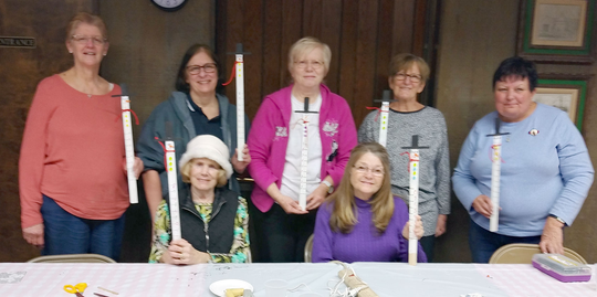 (Standing, from left) Ruth McGoldrick, Sue Medio, Doris Schalick, Zan Coia, Jean Adams, and (seated, from left) Ann Starkey and Marilyn Chappius show off snow measuring sticks they created during a craft night at the Woman's Club of Vineland.
