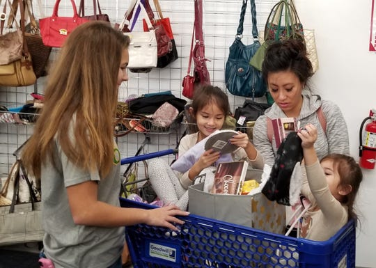 Summer Rusciano of Newfield, a freshman at Our Lady of Mercy Academy in Newfield, brightened this family's day at the Goodwill Store in Sewell by presenting a Smile Box as part of a Compassion Quest Mini-Mester course.