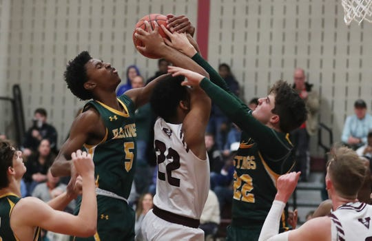 Hastings' Josh Thigpen (5) and Max Schapiro block the path of Valhalla's Drew Drayton-Bey (22) as he tries to drive to the basket during boys basketball action at the Kensico Middle School in Valhalla Jan. 18, 2020. Hastings won the game 74-59.