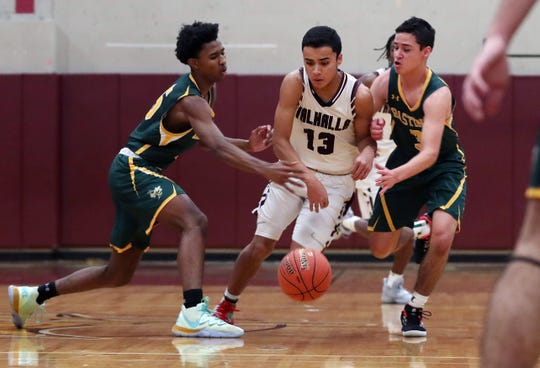 Valhalla's Sebastian Pacheco (13) tries to get by Hastings' Josh Thigpen and Robert Kennedy (3) during boys basketball action at the Kensico Middle School in Valhalla Jan. 18, 2020. Hastings won the game 74-59.