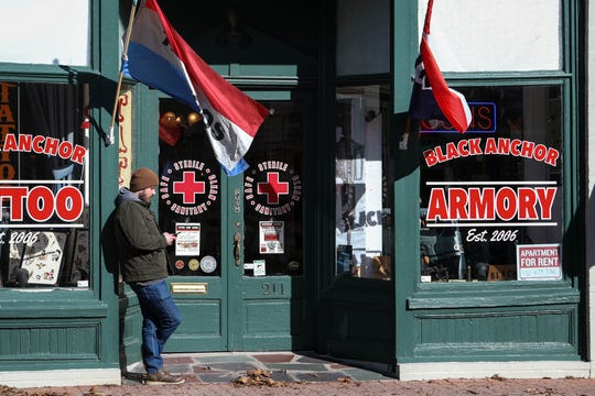 """Rural Denton hosts two gun shops on the main street. The town is home to William Bilbrough IV, who federal agents say is part of a """"violent"""" white supremacist group. He was arrested Thursday."""