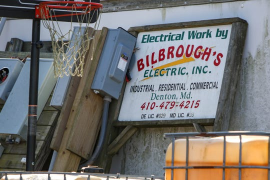 """A sign for """"Bilbrough's Electric, Inc."""" sits in a lot down a small dirt road in Denton. William Bilbrough IV, who federal agents say is part of a """"violent"""" white supremacist group, was arrested on Thursday."""