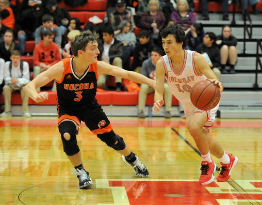 Nocona's Landry McCasland (3) defends Holliday's Keegan Hutchins in a District 8-3A game in Holliday on Friday, Jan. 17, 2020.