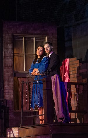 """Maria (Sydney Wisdom) and Tony (Andrew Murrow) enjoy a precious moment of happiness in The Wichita Theatre's """"West Side Story."""""""