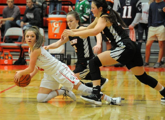 Holliday's Scotta Anderson recovers a loose ball as Nocona's Sydni Messer and Karlee Brown in a District 8-3A game in Holliday on Friday, Jan. 17, 2020.