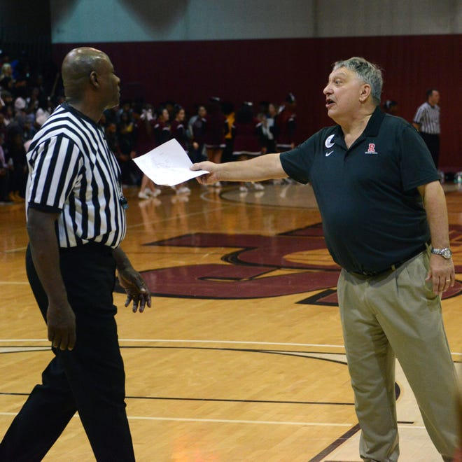 Rosecrans coach Todd Rock speaks with an official during a timeout against visiting Rosecrans' 63-51 loss to Canal Winchester Harvest Prep. The Bishops earned a No. 1 seed at the Division IV sectional tournament draw on Sunday.