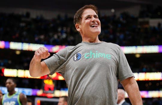 Dallas Mavericks owner Mark Cuban celebrates the team's 120-112 win over the Portland Trail Blazers in an NBA basketball game Friday, Jan. 17, 2020, in Dallas.