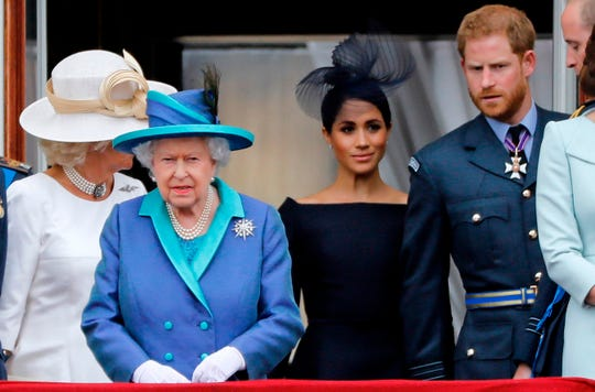 Duchess of Cornwall, Britain's Queen Elizabeth II, Britain's Meghan, Duchess of Sussex, Britain's Prince Harry, Duke of Sussex, and Britain's Prince William, Duke of Cambridge come onto the balcony of Buckingham Palace.