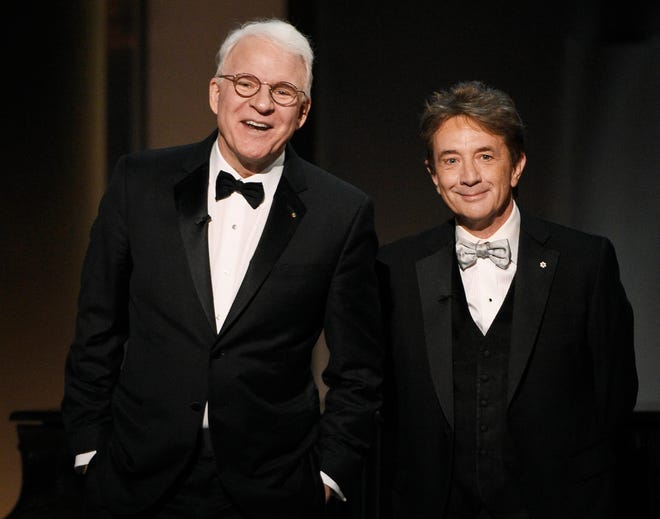 In this June 8, 2017 file photo, Steve Martin, left, and Martin Short appear at the 45th AFI Life Achievement Award Tribute to Diane Keaton in Los Angeles.  Steve Martin and Martin Short are taking their touring act to television with a new Hulu comedy.