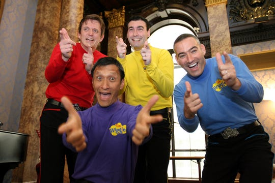 n this June 28, 2006 file photo, Australian children's entertainers The Wiggles, Murray Cook (Red Wiggle), Greg Page (Yellow Wiggle), Jeff Fatt (Purple Wiggle), and Anthony Field (Blue Wiggle) make a special appearance at the Australian High Commission in London at the start of their UK tour. Page, one of the original members of the popular Australian children's band has been hospitalized after collapsing during a wildfire relief concert.  Page fell as he left a stage in New South Wales and went into cardiac arrest. He had been performing with the other original bandmates to raise money for the Red Cross and the wildlife rescue group.