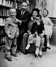 Dr. Martin Luther King Jr. and Coretta Scott King with Martin Luther King III, 5, Dexter Scott, 2, and Yolanda Denise, 7, in Atlanta on March 17, 1963.