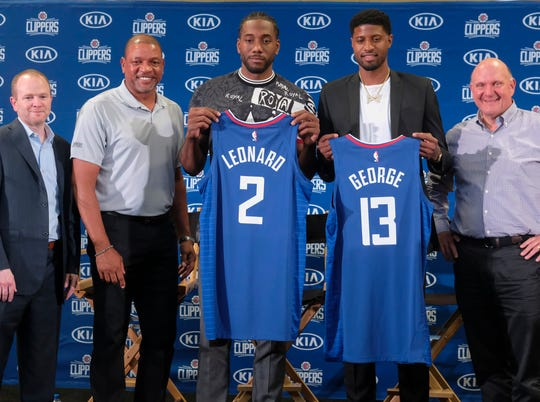 Lawrence Frank, far left, and the Clippers revamped the roster this offseason with Kawhi Leonard and Paul George.
