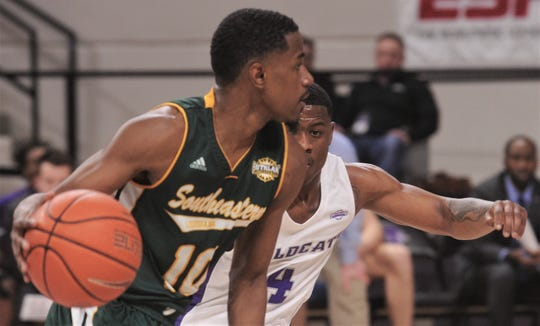 ACU's Damien Daniels, right, defends against Southeastern Louisiana's Von Julien in the second half. ACU beat the Lions 76-55 in the Southland Conference game Saturday, Jan. 18, 2020, at Moody Coliseum.