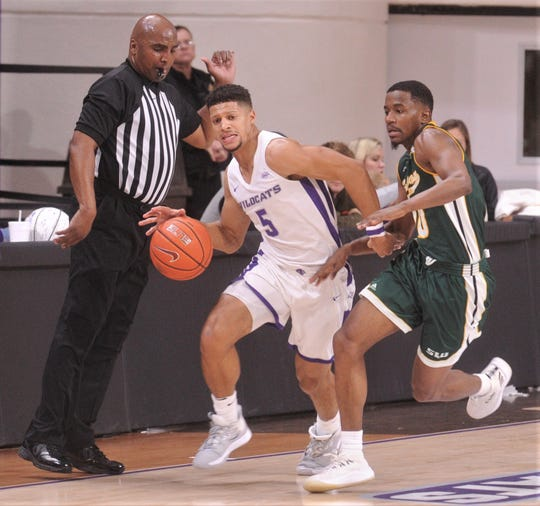 ACU's Payten Ricks (5) brings the ball up court as Southeastern Louisiana's Von Julien defends in the second half. ACU beat the Lions 76-55 in the Southland Conference game Saturday, Jan. 18, 2020, at Moody Coliseum.