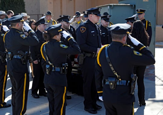 Nicholas Reyna's police academy classmates walk the casket to the procession during the funeral service for him Saturday, Jan. 18, 2020, at Trinity Church in Lubbock, Texas.