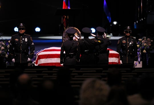 The Lubbock Police Department honor guard stand by the casket during the funeral service for officer Nicholas Reyna, Saturday, Jan. 18, 2020, at Trinity Church in Lubbock, Texas.