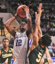 ACU's Mahki Miller (12) shoots over Southeastern Louisiana's Byron Smith in the second half. ACU beat the Lions 76-55 in the Southland Conference game Saturday, Jan. 18, 2020, at Moody Coliseum.