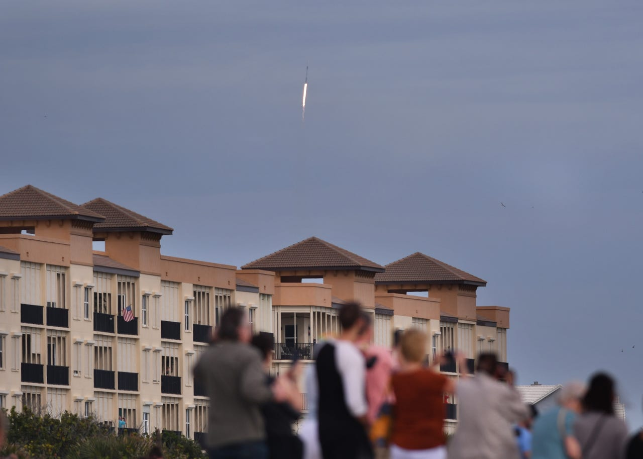Thousands lined the beaches of Cocoa Beach, Cape Canaveral and Jetty Park Sunday morning to watch the 10:30 a.m. liftoff of a Falcon 9 with a Crew Dragon  capsule. The capsule successfully separated from the rocket and splashed down in the Atlantic Ocean shortly after liftoff.