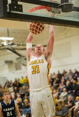 Colonel Crawford's Chase Walker dunks on a breakaway.