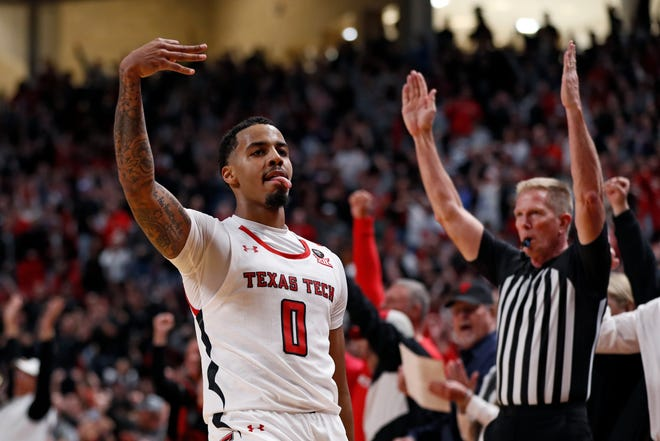 Texas Tech's Kyler Edwards (0) celebrates after scoring a three-point shot during the second half of Big 12 Conference game Jan. 18 against Iowa State at United Supermarkets Arena.