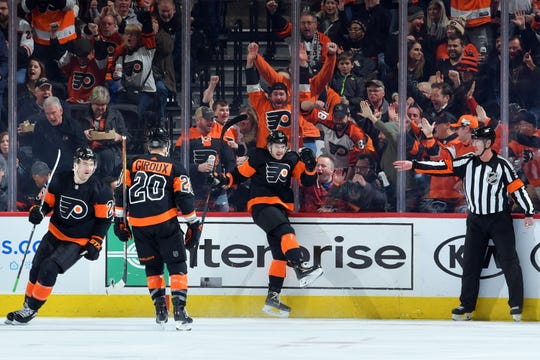 Claude Giroux's new line, with him back at center, produced three goals in a 4-1 win over Los Angeles.