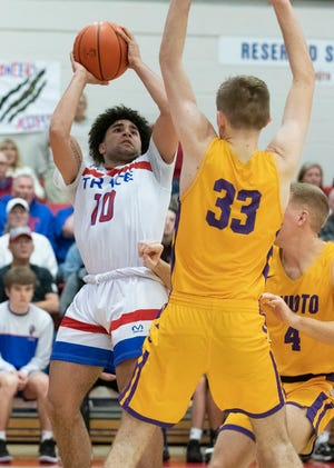 Zane Trace's Cam Evans goes up for a jump shot during a 51-37 win over Unioto at Zane Trace High School on Saturday, Jan. 18, 2020.