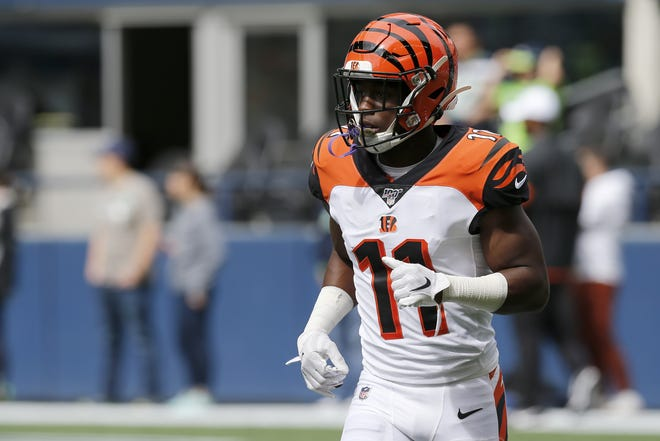 Cincinnati Bengals wide receiver John Ross (11) runs drills during warmups before the first quarter of the NFL Week 1 game between the Seattle Seahawks and the Cincinnati Bengals at CenturyLink Field in Seattle on Sunday, Sept. 8, 2019.