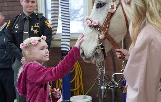 An 8-year-old Butler County girl battling brain cancer got a surprise Saturday,