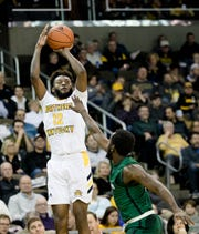 Northern Kentucky Norse guard Trevon Faulkner (12) shoots over Cleveland State Vikings guard Kasheem Thomas (2) in the second half of the NCAA basketball game on Saturday, Jan. 18, 2020, at the BB&T Arena in Highland Heights, Ky. NKU won 75-49.