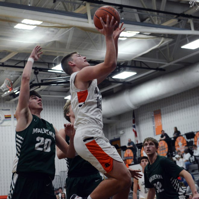 Trey Stoffer goes up for a layup against Malvern earlier this season. Stoffer was named the IVC South Division player of the year.