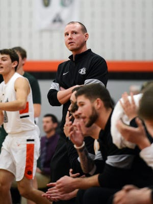 Ridgewood coach Troy Dolick glances at the scoreboard during his team's 59-56 win against Malvern. the win kept the Generals unbeaten in Inter-Valley Conference play at 7-0. Ridgewood earned the top seed in the Division III sectional tournament draw on Sunday.