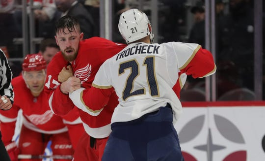 Detroit Red Wings defenseman Filip Hronek fights with Florida Panthers center Vincent Trocheck during the first period at Little Caesars Arena in Detroit, Saturday, Jan. 18, 2020.