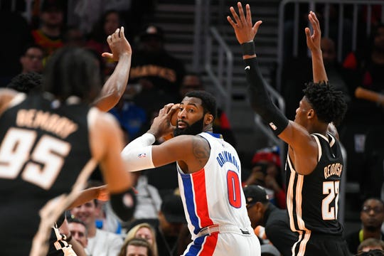 Detroit Pistons center Andre Drummond looks to pass as Atlanta Hawks forward Cam Reddish, right, defends during the first half Saturday, Jan. 18, 2020, in Atlanta.